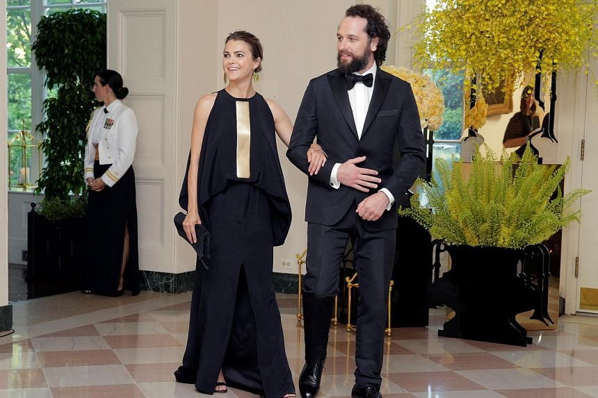 Actors Keri Russell and Matthews Rhys arrive for a State Dinner hosted by US President Barack Obama for Singapore Prime Minister Lee Hsien Loong at the White House in Washington, US on Aug 2.