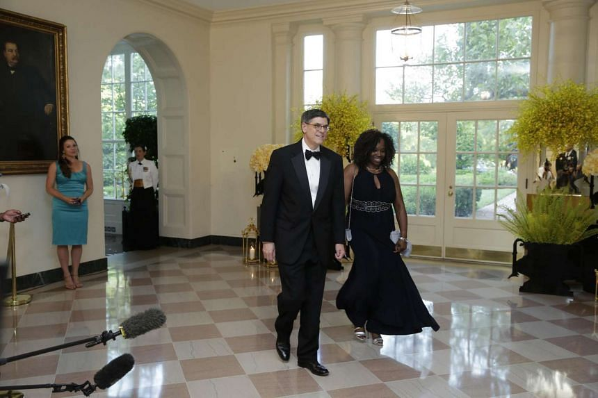 US Treasury Secretary Jack Lew and Ms. Shirley Gathers arrive at a State Dinner in honor of Prime Minister Lee Hsien Loong of Singapore at the White House in Washington on Aug 2.