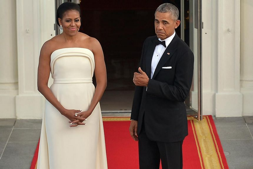 Mr and Mrs Obama arrive at the White House for the state dinner on Aug 2.
