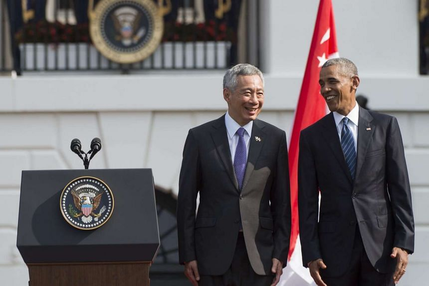 PM Lee Hsien Loong and US President Barack Obama sharing a light moment on the stage at the welcome ceremony, at the White House, on Aug 2, 2016.