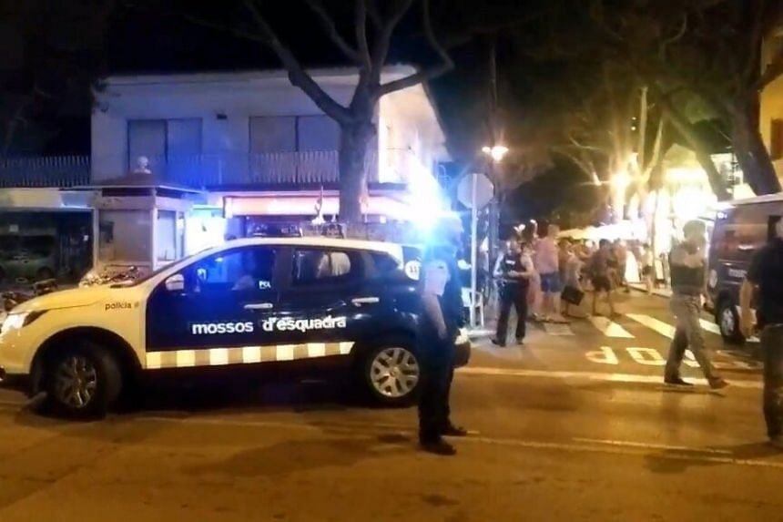 Police at the scene of the flash mob in Platja d'Aro on Aug 2, 2016.