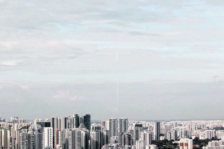 The view of the Singapore skyline from the 32nd floor of the Singtel building along Exeter Road.