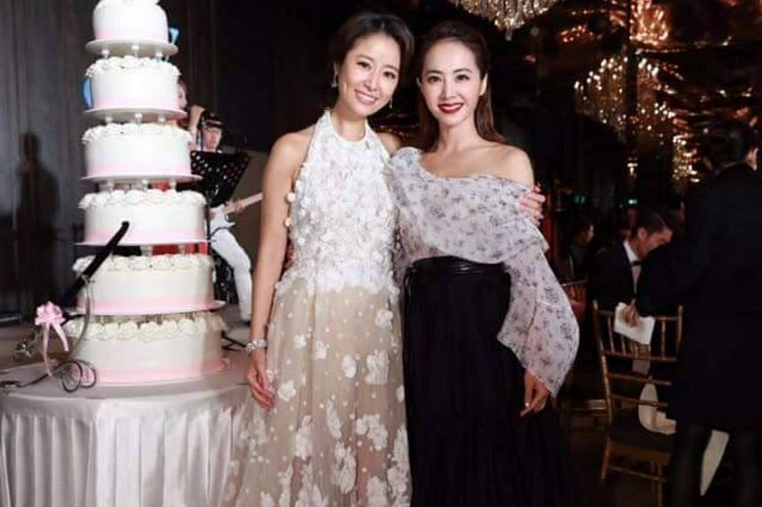 Jolin Tsai (right) with Ruby Lin at her wedding on July 31.