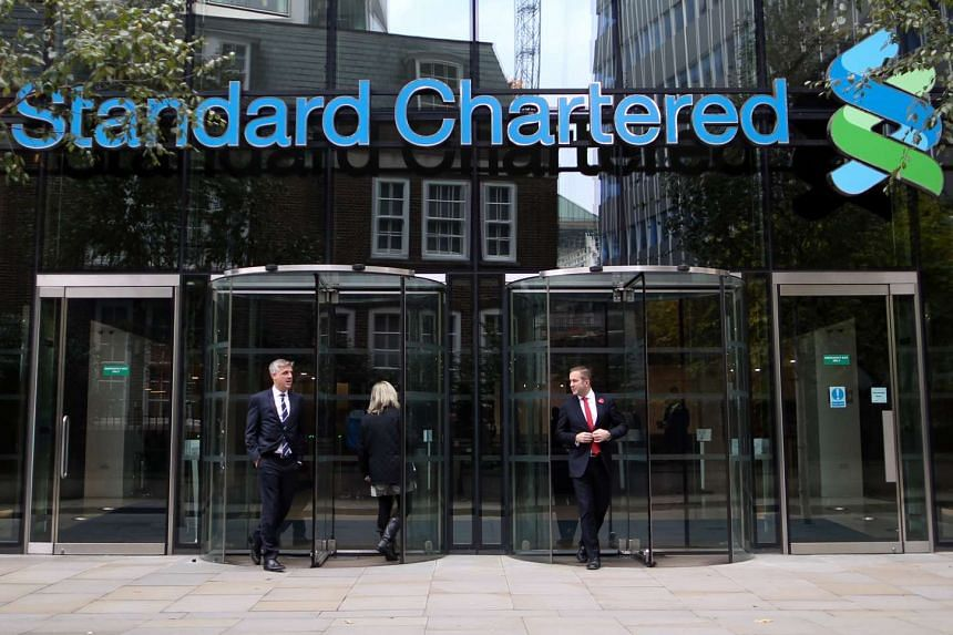 Cost-cutting measures helped Standard Chartered swing back into the black in the first half of 2016.