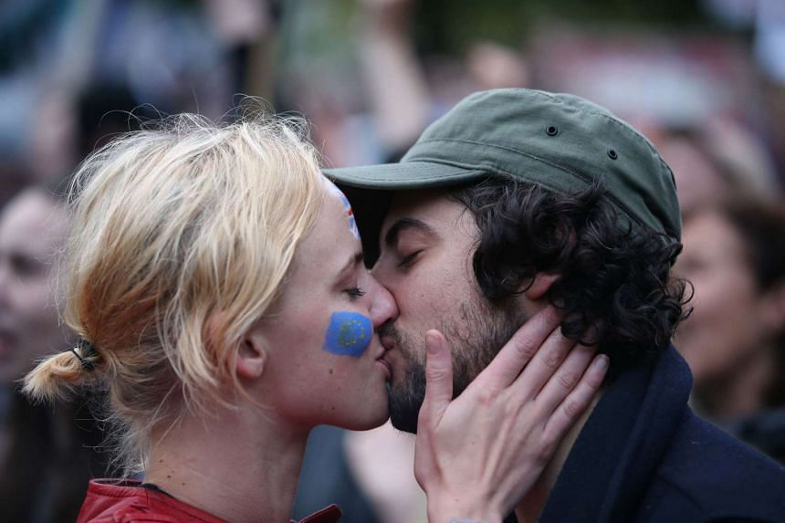 A couple kissing at an anti-Brexit protest in Trafalgar Square in central London on June 28, 2016.