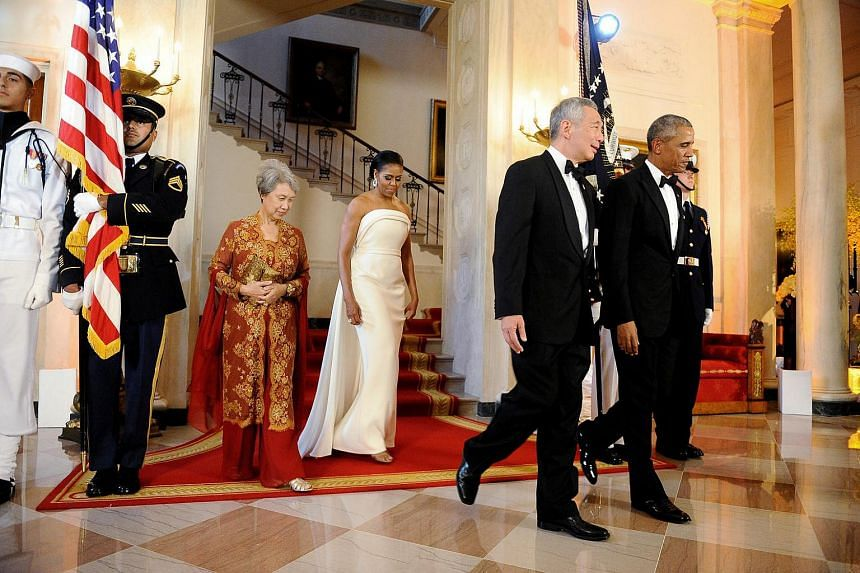 US President Barack Obama and first lady Michelle Obama welcome Singapore Prime Minister Lee Hsien Loong and his wife Mrs Lee Hsien Loong to the White House in Washington, DC.