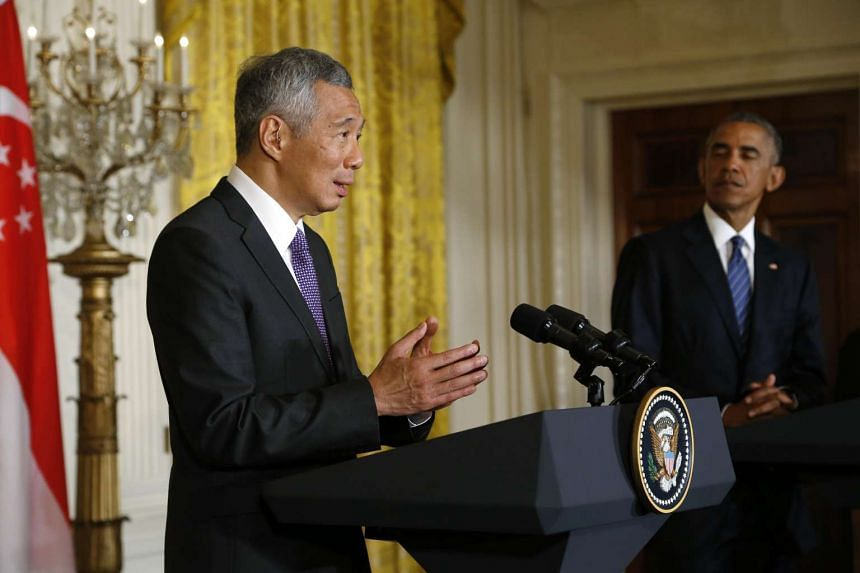 PM Lee addresses the joint news conference as President Obama looks on at the White House in Washington on Aug 2, 2016.