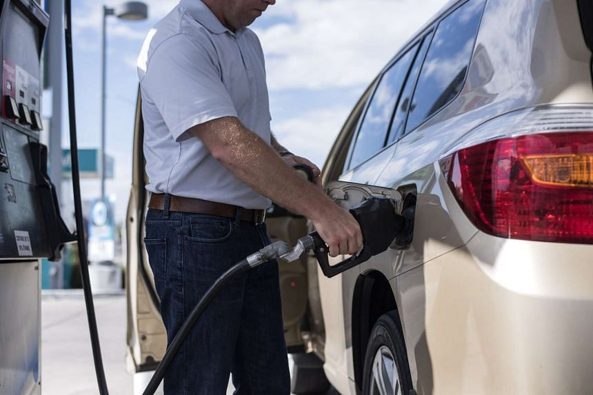 A man pumps gas into his car in Albuquerque, New Mexico, US, on July 26, 2016.