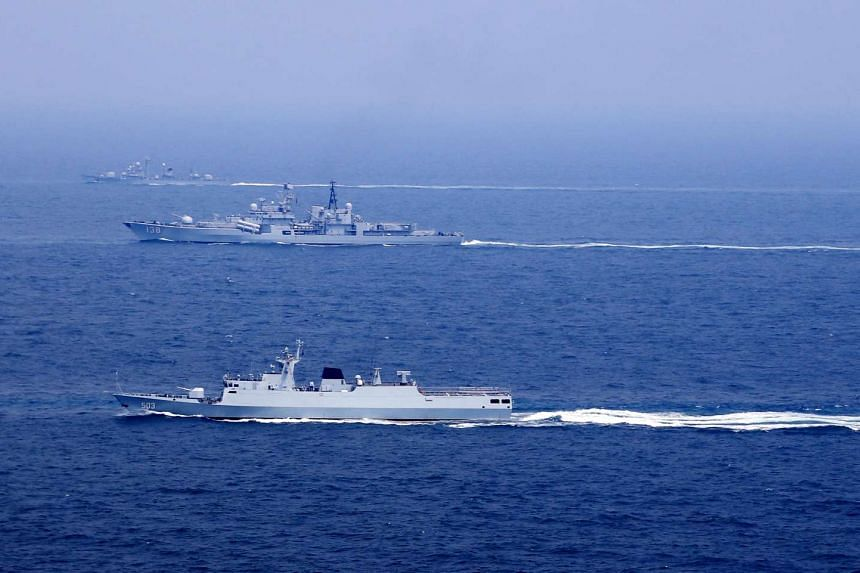 Chinese naval vessels participate in a drill on the East China Sea, China on Aug 1.