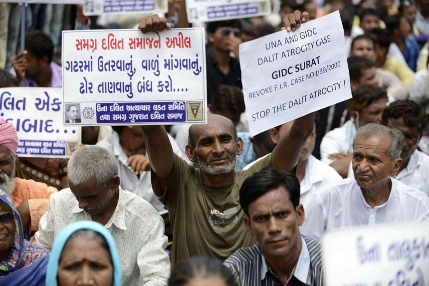 Ms Patel resigned on Monday following protests by the Dalit community (above), triggering a search for a successor.