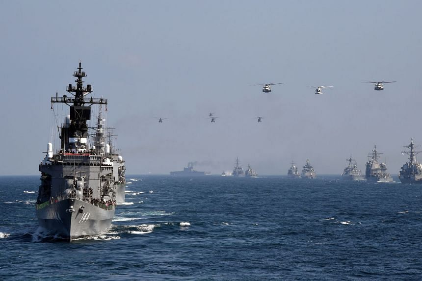Japanese navy ship Kurama taking part in a fleet review off Japan's Sagami Bay last year, together with the navies of Australia, India, France, South Korea and the United States. Tensions between Tokyo and Beijing over islets in the East China Sea - known