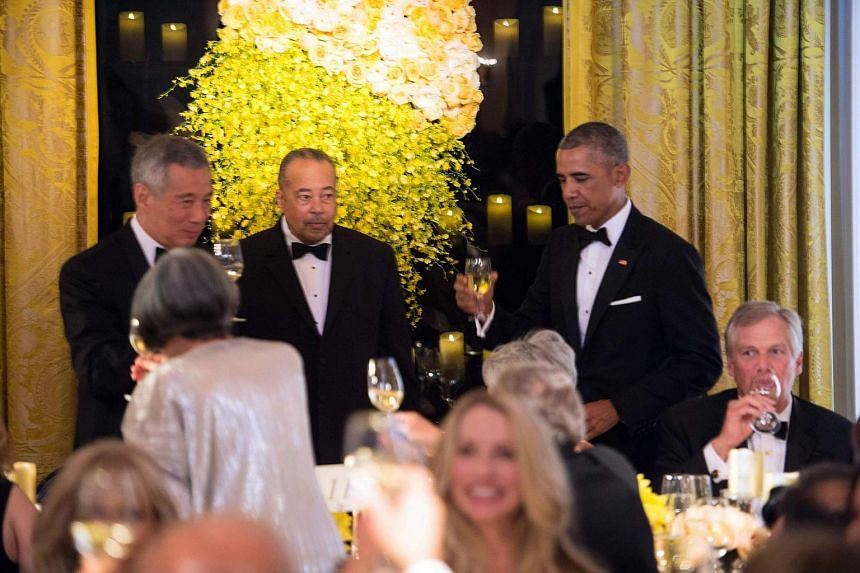 US President Barack Obama offers a toast to Singapore's Prime Minister Lee Hsien Loong (left) and his wife Mrs Lee at the state dinner at the White House in Washington, DC.