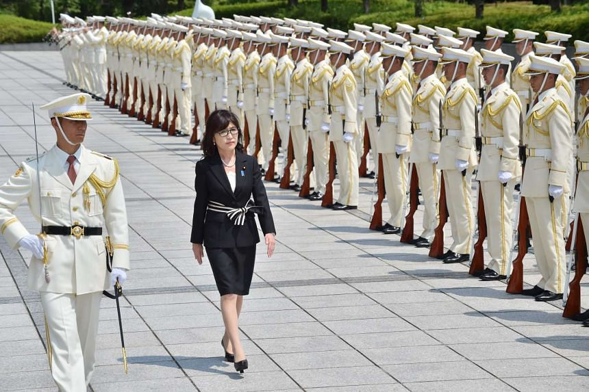 New Japanese Defence Minister Tomomi Inada (second from left) reviews an honour guard at a welcoming ceremony at the Defence Ministry in Tokyo, on Aug 4, 2016.