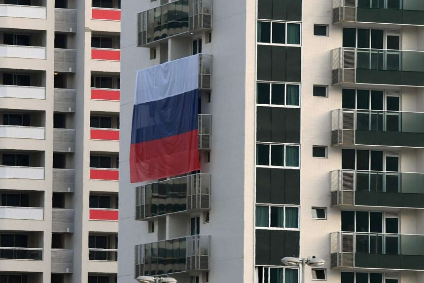 A Russian flag is displayed at the Rio 2016 Olympic Village for Athletes on July 25 in Rio de Janeiro.