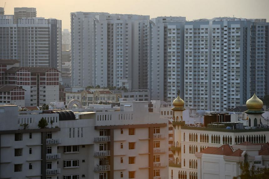 Commercial buildings, a mosque and housing apartments seen from Block 11 Pine Close on July 16.