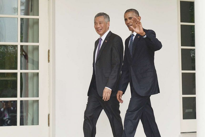 PM Lee and Mr Obama make their way to the Oval Office.
