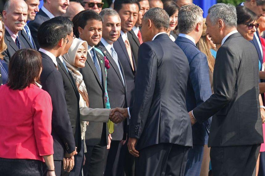 Mr Obama shakes hands with MP Rahayu Mahzam.