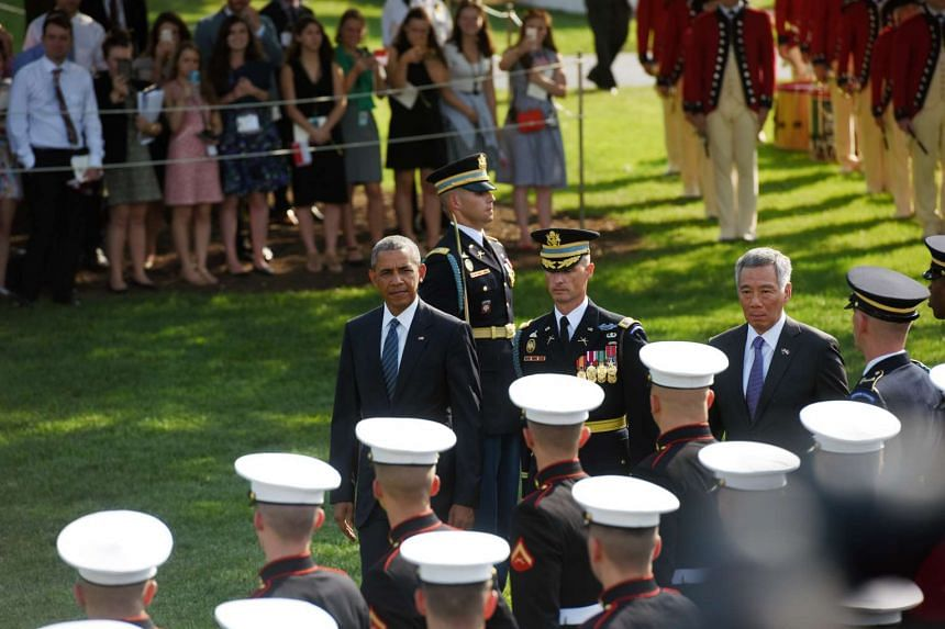 Mr Obama and Prime Minister Lee inspect the guard-of-honour.