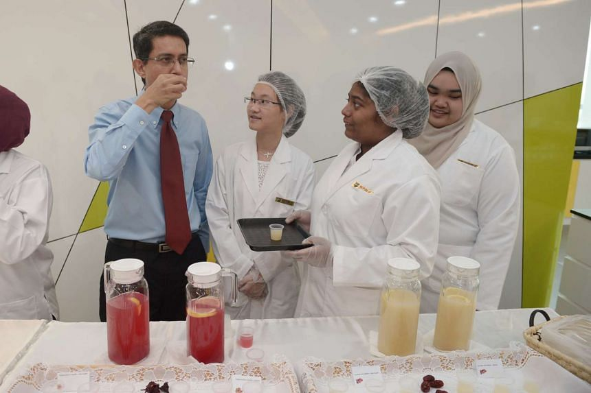 Students from the Diploma in Biotechnology, School of Applied Sciences (from left) Yeoh Jia Le, 20, Theresa Kanayar, 19 and Nur Sabrina, 20 presented drinks made using natural sweeteners to Associate Professor Muhammad Faishal Ibrahim, Parliamentary