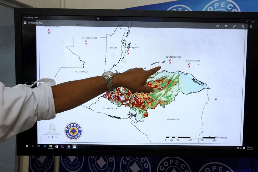 A member of Copeco monitors the trajectory of Tropical Storm Earl, in Tegucigalpa, Honduras, Aug 3, 2016.