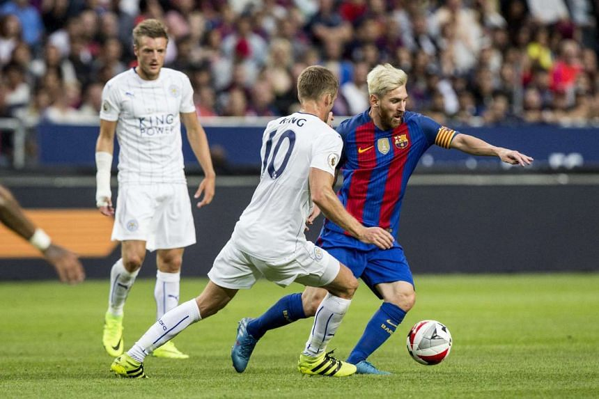 Leicester City's Andy King challenges Barcelona's Lionel Messi during the International Champions Cup game between FC Barcelona and Leicester City FC at Friend's Arena in Stockholm, Sweden on Aug 3, 2016.