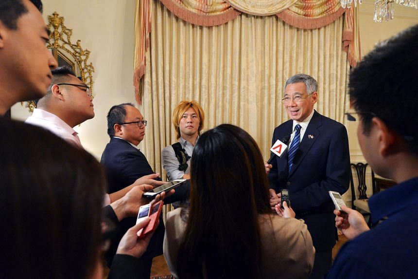 Prime Minister Lee Hsien Loong holds a press conference with the Singapore media at the Blair House on August 4.