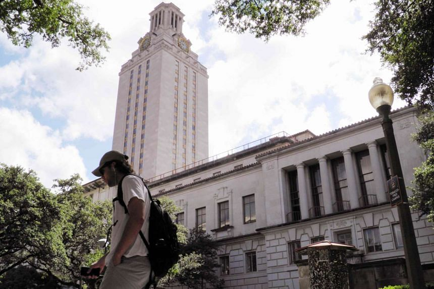 A student walks at the University of Texas campus in Austin, Texas, on June 23, 2016.