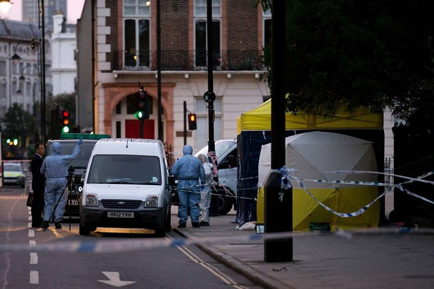 Police forensic officers work in Russell Square in London early on Aug 4, 2016, after a woman in her 60s was killed during a knife attack.
