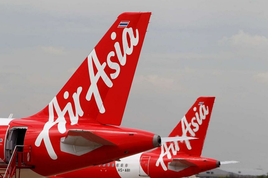 AirAsia planes prepare for take off at Don Mueang International Airport in Bangkok, on June 29, 2016.