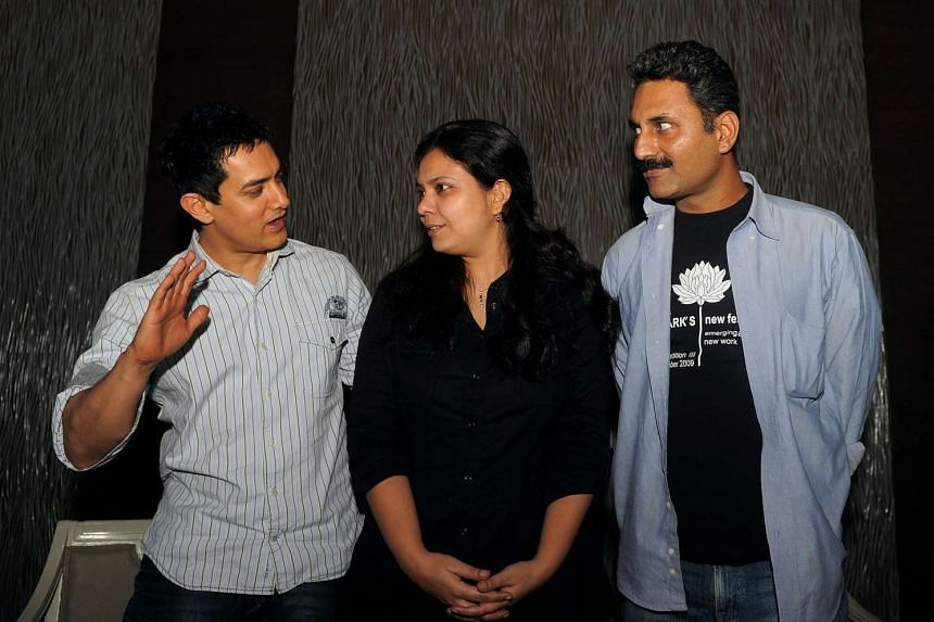 Bollywood actor Aamir Khan (left) with writer and directors Anusha Rizvi (centre) and Mahmood Farooqui (right) at a promotional event for Peepli Live in New Delhi, on July 7, 2010.