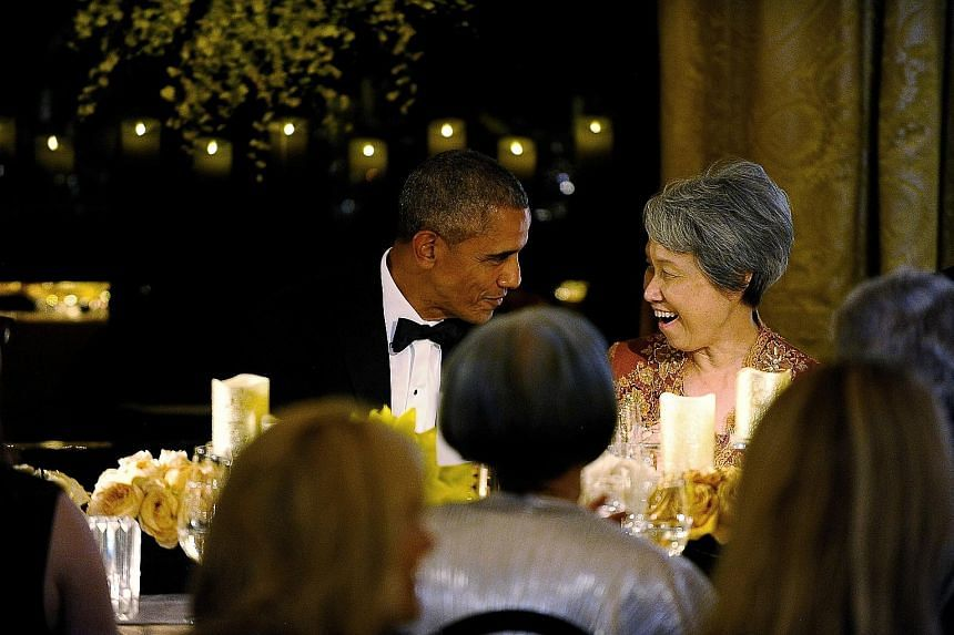 """Left: PM Lee and Mr Obama toasting their friendship at the state dinner. Both spoke warmly of each other during their speeches, with PM Lee saying Singapore admires America's """"dynamism, vibrancy and capacity for self-renewal"""". Left below: Mr Obama an"""
