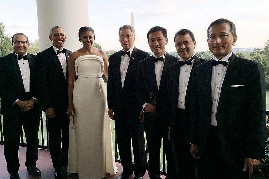 Mr Obama and his wife Michelle with PM Lee and members of the Singapore team - (from left) Minister for Trade and Industry (Industry) S. Iswaran, Acting Minister for Education (Higher Education and Skills) Ong Ye Kung, MP Christopher de Souza and For