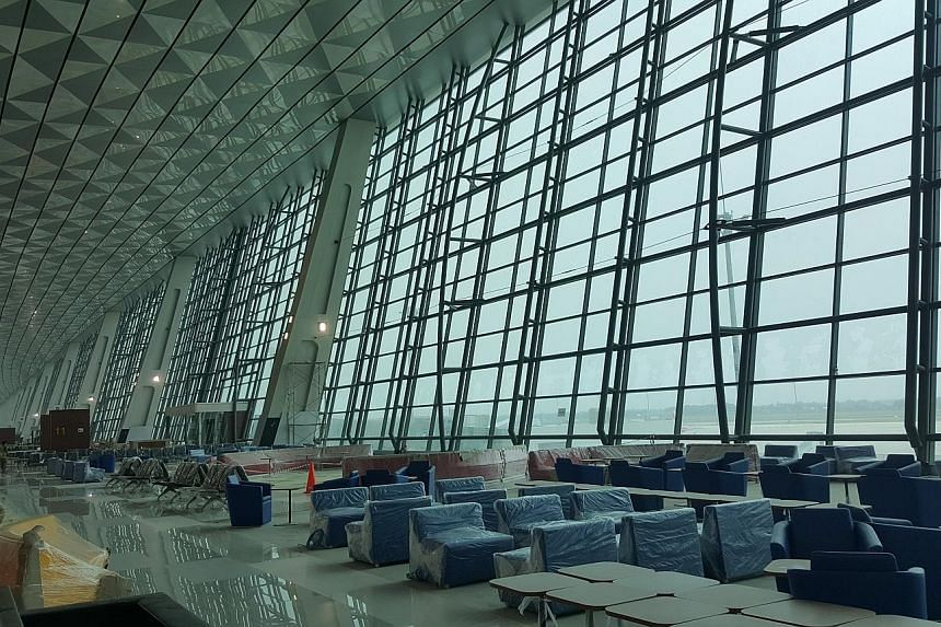 The opening of Terminal 3 (left) of the Soekarno-Hatta International Airport has been delayed for nearly two months over blind spots at some of its aprons as well as power supply issues.