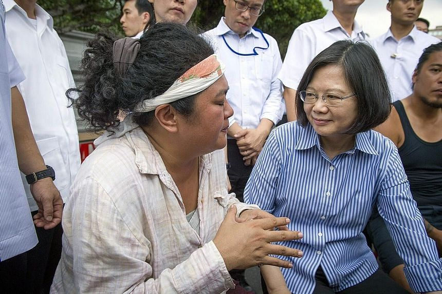 Ms Tsai met aboriginal singer Panai Kusui (left) and other protesters for 30 minutes yesterday. She said her government would implement measures to grant greater autonomy to the indigenous communities.
