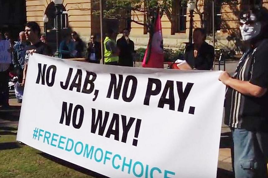 "A protest in Australia in June last year against the country's controversial ""no jab, no pay"" policy to compel parents to get their children vaccinated. ""Anti-vaxxers"" say standard vaccines can cause autism and pose unneccesary risks to children - cl"