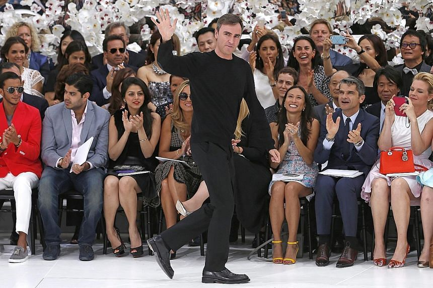 Belgian designer Raf Simons (left) at his Haute Couture Autumn-Winter runway show for Christian Dior in Paris in July.
