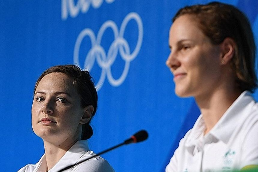 Sisters Cate (far left) and Bronte Campbell speaking to the media during the Australian swim team's press conference in Rio on Tuesday. They are rivals for the 100m freestyle title but team-mates in the relay.