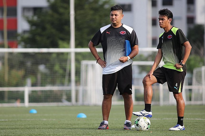 New Home United coach Aidil Sharin (far left) and Juma'at Jantan at training. Despite performing relatively well and developing younger players, Philippe Aw was removed from the club's top coaching post and redeployed as head of youth development and
