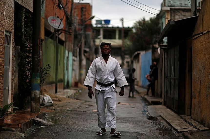 Popole Misenga, originally from the Democratic Republic of Congo and a judoka, pictured near his home in a slum in Rio de Janeiro. He is one of the 10-member Refugee Olympic Team.