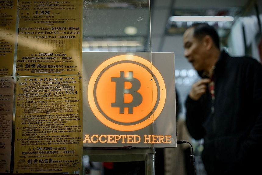 A shop in Hong Kong displaying a sign saying it accepts bitcoins. The value of the often-volatile currency plunged more than 20 per cent yesterday after bitcoin exchange Bitfinex discovered hackers had taken 119,756 bitcoins, or about $87.2 million a