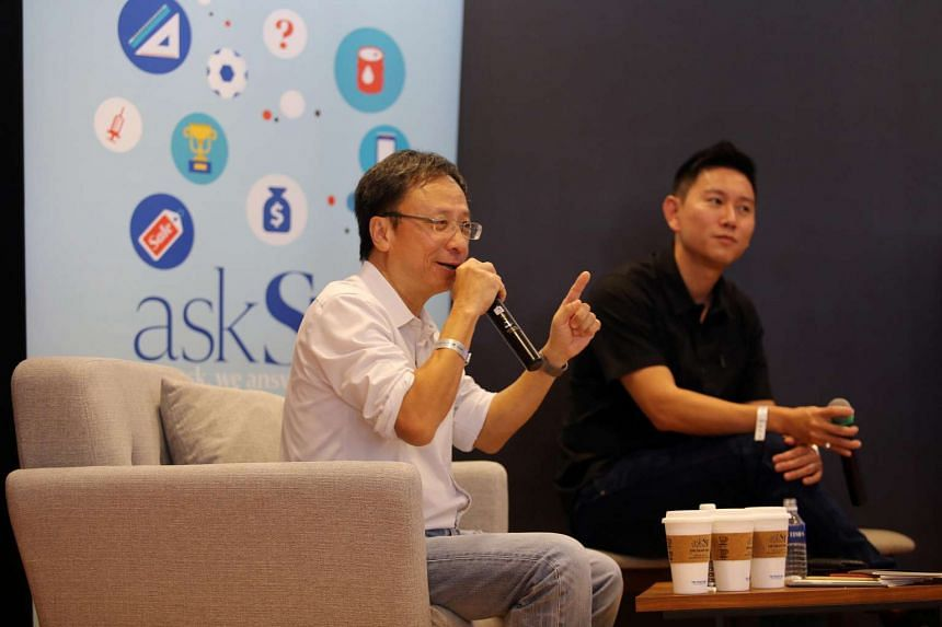 Senior transport correspondent Christopher Tan (left) giving a talk at the Singapore Coffee Festival in June.