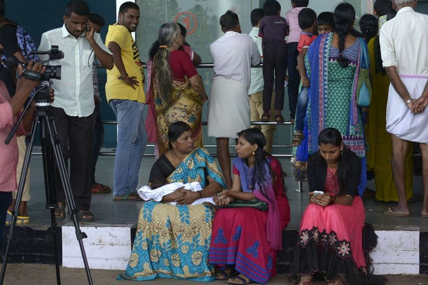 Passengers and relatives wait for news at the departures terminal of Thiruvananthapuram International Airport on Aug 3, 2016.