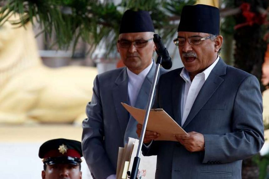 Newly-elected Nepalese Prime Minister Pushpa Kamal Dahal, also known as Prachanda, administers the oath of office at the presidential building in Kathmandu on Aug 4, 2016.