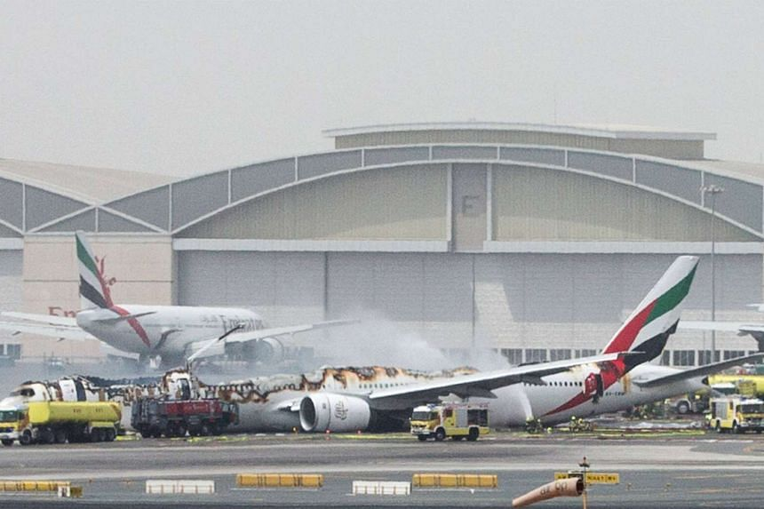 An Emirates Airline flight is seen after it crash-landed at the Dubai International Airport on Aug 3, 2016.