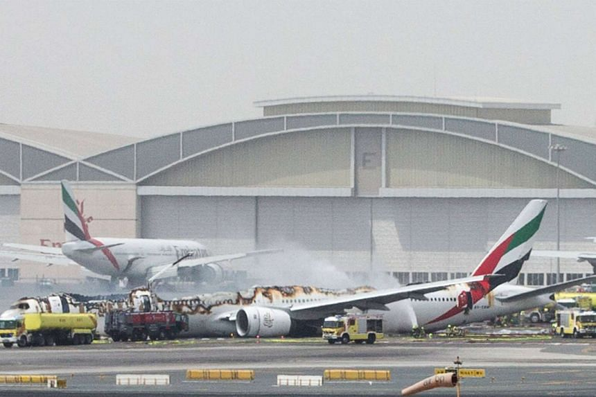 An Emirates Airline flight is seen after it crash-landed at Dubai International Airport on Aug 3, 2016.
