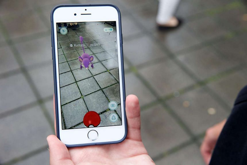 A smartphone screen shows the Pokemon Go app in Brussels on Aug 3, 2016.