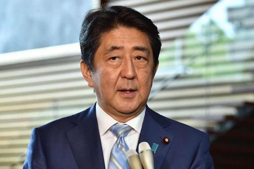 Japanese PM Shinzo Abe speaks to reporters in Tokyo on Aug 3, 2016, following the ballistic missile launch by North Korea.