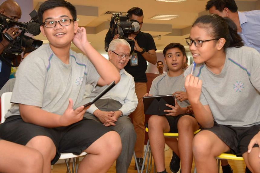 President Tan joining an English class yesterday at Spectra Secondary School in Woodlands where students took part in a quiz on their tablets. Dr Tan said schools like Spectra provide different pathways to success.