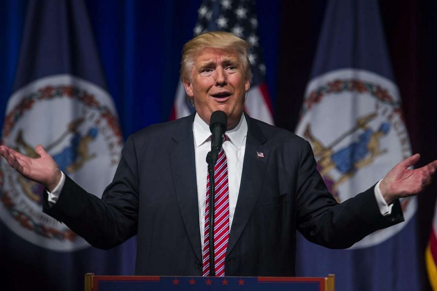 Trump (above) has shrugged off a growing party backlash over his public dispute with the parents of a Muslim US Army captain killed in the Iraq war in 2004.