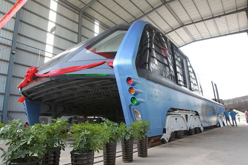 A model of an innovative street-straddling bus called Transit Elevated Bus is seen after a test run in Qinhuangdao, Hebei Province, China on Aug 3, 2016.
